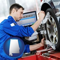 alabama a mechanic adjusting a wheel alignment machine clamp