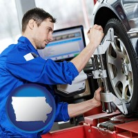 iowa a mechanic adjusting a wheel alignment machine clamp