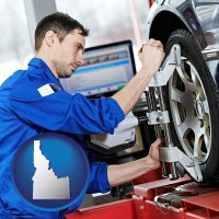 idaho a mechanic adjusting a wheel alignment machine clamp