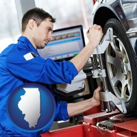 illinois a mechanic adjusting a wheel alignment machine clamp