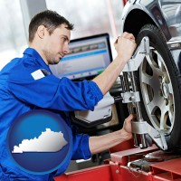 kentucky a mechanic adjusting a wheel alignment machine clamp