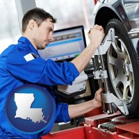 louisiana a mechanic adjusting a wheel alignment machine clamp