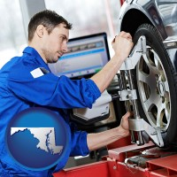 maryland a mechanic adjusting a wheel alignment machine clamp