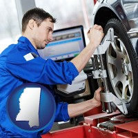 mississippi a mechanic adjusting a wheel alignment machine clamp