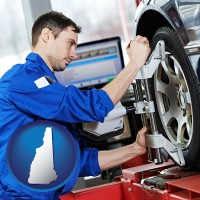 new-hampshire a mechanic adjusting a wheel alignment machine clamp