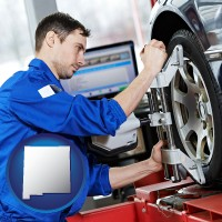 new-mexico map icon and a mechanic adjusting a wheel alignment machine clamp
