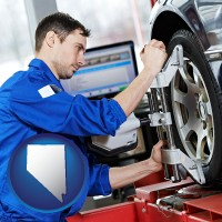 nevada a mechanic adjusting a wheel alignment machine clamp