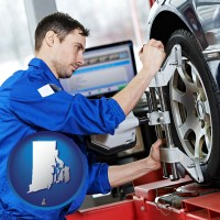 rhode-island a mechanic adjusting a wheel alignment machine clamp