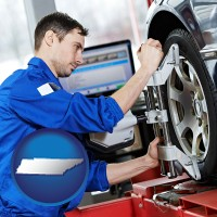 tennessee a mechanic adjusting a wheel alignment machine clamp