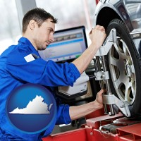 virginia a mechanic adjusting a wheel alignment machine clamp