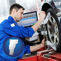 vermont a mechanic adjusting a wheel alignment machine clamp