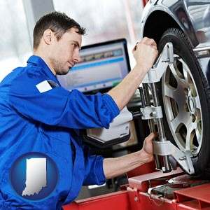 a mechanic adjusting a wheel alignment machine clamp - with Indiana icon
