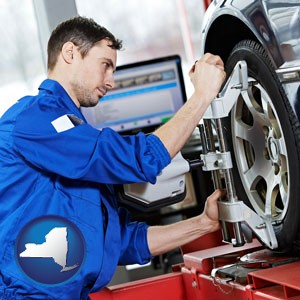 a mechanic adjusting a wheel alignment machine clamp - with New York icon
